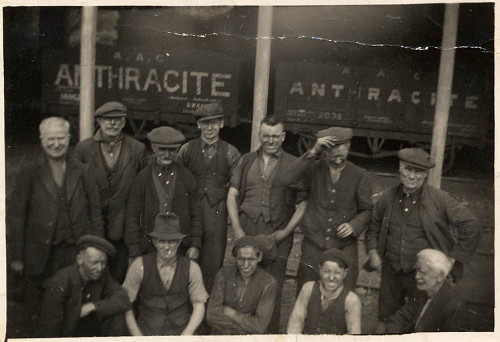 Photograph of Ammanford colliers and workmen standing in front of anthracite truck, c 1900.