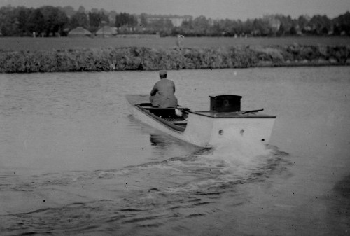 Image from a glass plate negative showing the rear view of the first all British motor boat, 1894.