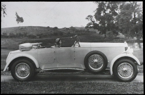 George Lanchester's daughter Nancy in the driver's seat of a 4-door Straight 8 Lanchester, 1930.