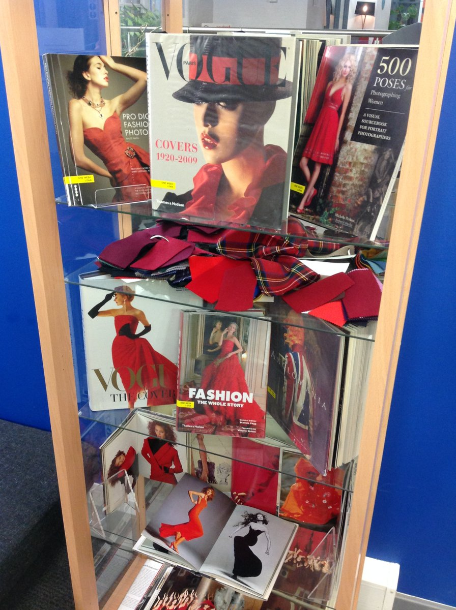 Photo of book display related to Project Red fashion show at The Cass