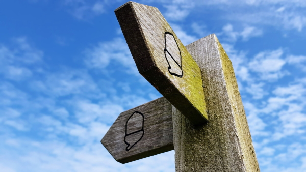 signpost with two directions marked with fingers